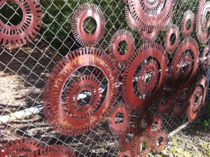 Gears on a fence